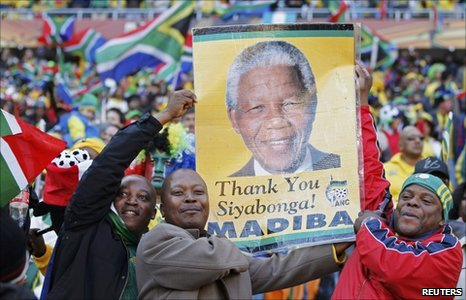 South African fans carry Nelson Mandela poster