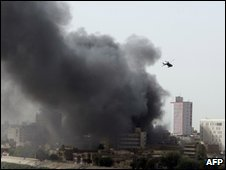 Smoke over Baghdad from string of explosions near Iraq central bank building - 13 June 2010