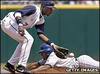 Donnie Sadler of the Texas Rangers steals second base against Cleveland