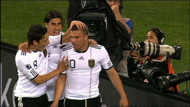 Lukas Podolski celebrates with his German team-mates