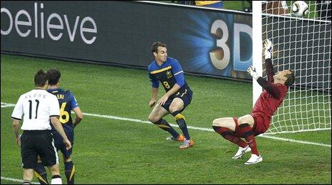 Australian keeper Mark Schwarzer is unable to keep out Podolski's effort