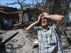 Ethnic Uzbek man by his burned home in Osh, Kyrgyzstan (14 June 2010)