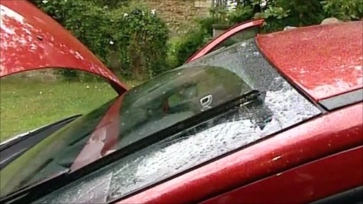 Car windscreen with wipers switched on