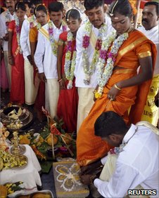 Former Tamil Tiger fighters take part in a mass wedding in Vavuniya on June 13, 2010