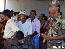 Army soldiers take down the details of families as they return to their homes, after they were released from Manik Farm Internally Displaced Persons (IDP) camp near Vavuniya, 254 km (158 miles) north of Colombo, May 13, 2010