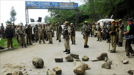 Indian security forces stand guard at the Mao Gate Bazar just after a crowd waiting to welcome a separatist leader was dispersed at the Nagaland-Manipur state border, 109 km from Imphal, capital city of Manipur, on May 6, 2010.