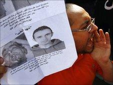 Activist with image of Khaled Said