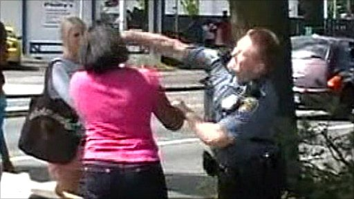 The officer lands the punch