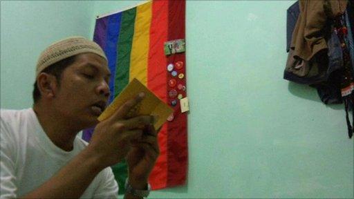 Hartoyo, a gay activist prays