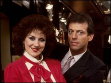 Anita Dobson as Angie and Leslie Grantham as Den Watts