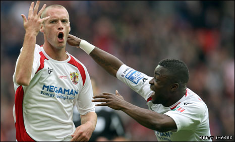 Stevenage's Andy Drury and Yemi Odubade