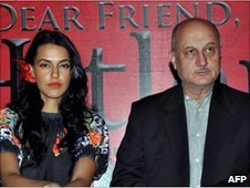 """Bollywood actress Neha Dhupia and actor Anupam Kher attend a ceremony for """"Dear Friend Hitler"""" in Mumbai on 6 June 2010"""