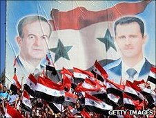 flag showing President Hafez al-Assad and his son President Bashar al-Assad