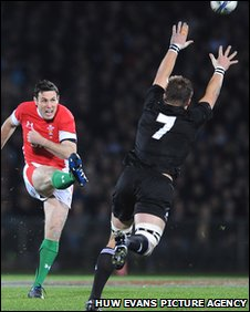 Fly-half Stephen Jones connects with an early drop-goal for Wales