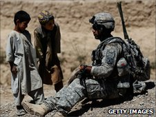 US soldier talks with Afghan boys