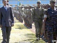 Rwandan President Paul Kagame inspects a military parade in Kigali