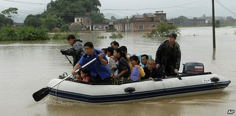 In residents are evacuated after heavy rains caused floods in  Huaiji in south China's Guangdong province (15 June)