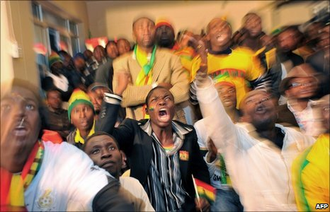 Fans of Ghana's football squad cheered as they watched the 2010 World Cup match Ghana v Australia in Yeoville, a suburb of Johannesburg - 19 June 2010