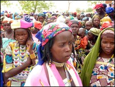 Women and children queue at a feeding centre near Niger's third-largest city, Maradi