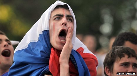 A French fan watches them play in the fan zone in Paris