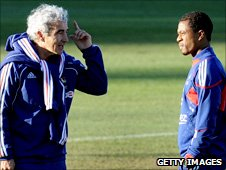 France Manager Raymond Domenech (left) and Captain Patrice Evra talk on 20 June