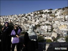 Local women stand above Silwan