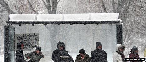 People wait at bus shelter