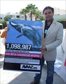 Luis Morago of Avaaz with placard