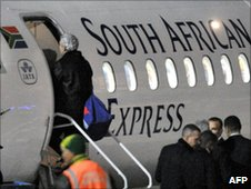 Raymond Domenech gets on a plane in South Africa