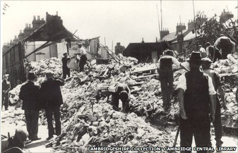 Workers inspect bomb damage, Vicarage Terrace, Cambridge, 1940