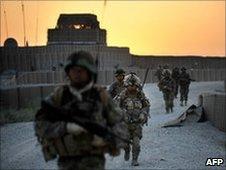 Soldiers patrol near Nahr e Saraj village, in Helmand on June 23, 2010