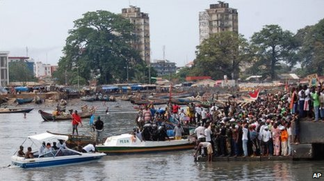 Supporters of former prime minister Lansana Kouyate gather at a port in Conakry