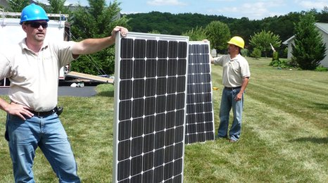 Solar panels are prepared for installation on a house in Berkeley Springs, West Virginia.