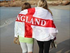 England fans walk along beach in Port Elizabeth, South Africa