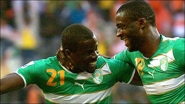 Ivory Coast&amp;apos;s Yaya Toure celebrates with Emmanuel Eboue
