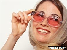 Woman in rose-tinted glasses