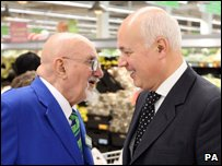 "Secretary of State for Work and Pensions Iain Duncan Smith meets 76 year old Roy Gill, the oldest employee at the Asda store on London""s Old Kent Road"