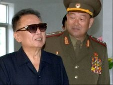 North Korean leader Kim Jong-il (left) in undated photo released  by KCNA