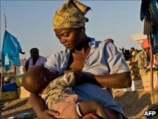 A mother and baby in Maputo, Mozambique, 9 June 2010