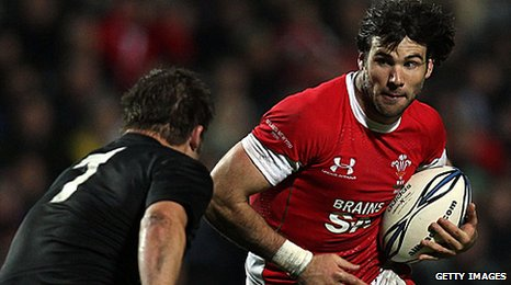 Mike Phillips takes on All Blacks captain Richie McCaw in Wales' 29-10 defeat in Hamilton