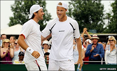 Britain's Chris Eaton (left) and Dominic Inglot during their victory over Daniel Nestor and Nenad Zimonjic at Wimbledon