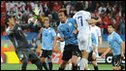 South Korea's midfielder Lee Chung-Yong (C-R) heads the ball past Uruguay's goalkeeper Fernando Muslera (L)