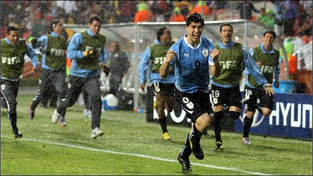 Luis Suarez celebrates followed by his team-mates