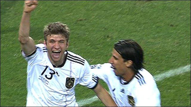 Thomas Mueller celebrates his second goal against England