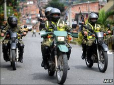 Soldiers on patrol in Medellin on 19 June 2010