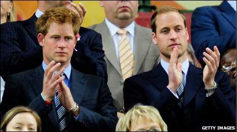 Prince Harry (left) and Prince William attend England's Group C match with Algeria