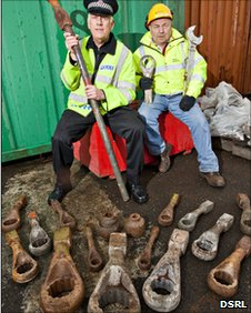 Police officer Bill Johnson and Dounreay worker with spanners. Pic: DSRL