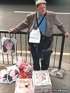 Newspaper seller with Diana front page