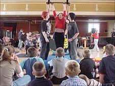 Children at a circus skills workshop