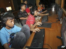 Indonesian youths at an Internet cafe in Jakarta (12 June)